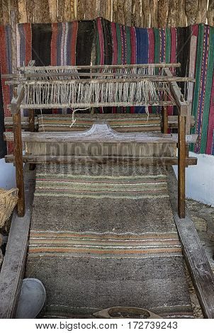 A traditional vintage bulgarian weaving loom with rug