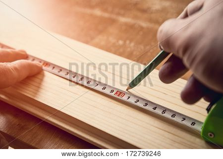 Measuring The Wooden Board