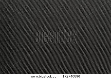 the textured background of fabric or textile material of dark gray or black color