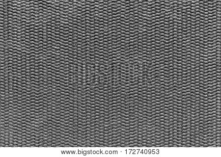 the abstract textured background of gray color of polymeric material or synthetic fabric with a corrugated symmetric pattern and with small droplets of water