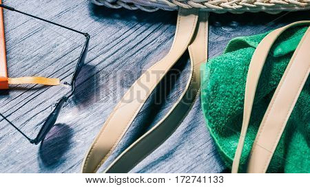 Summer fashion set with sunglasses and green towel