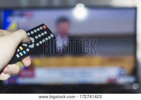 Watching Television online play finger display hand
