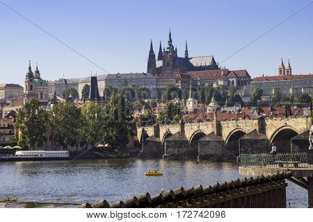 View of Prague castle and Charles Bridge with river Vlatva .