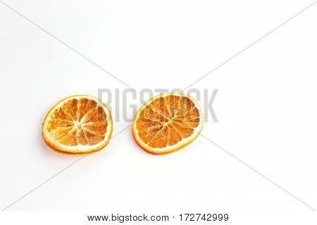 Orange slices dried out on a white background with room for copy space