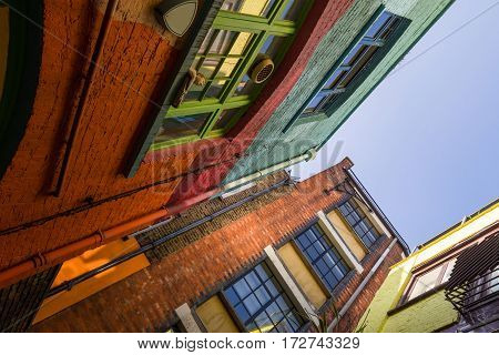 Corner in a very colorful building complex in london in a diagonal view with the sky in the background