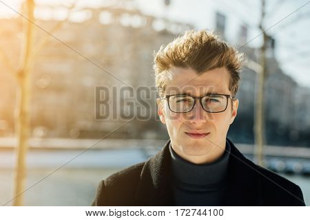 Smart Guy With Glasses Outside