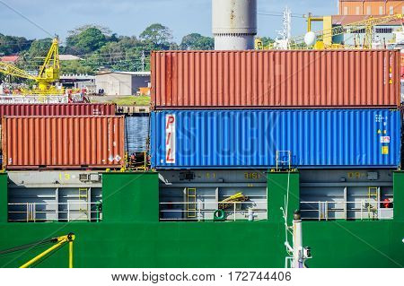 Labuan,Malaysia-May 11,2016:Stacked containers on the deck of cargo ship in Labuan port,Malaysia.Its a sheltered deep-water harbour which is an important transshipment point for Brunei Darussalam,Sarawak & Sabah