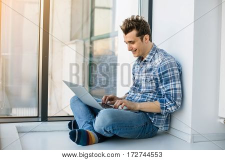 Young Man Lying Down With Laptop