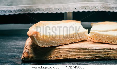 Pieces of homemade cheesecake on wooden serving board