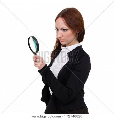 Surprised young woman with magnifying glass isolated on white background