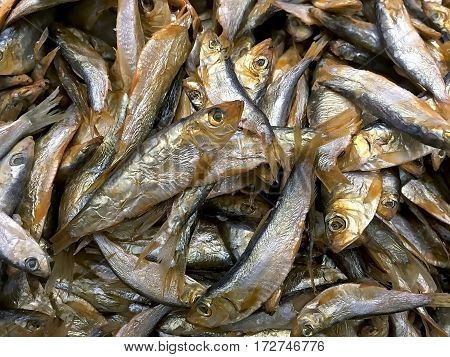 Food background - Dried and smoked fish sprats closeup