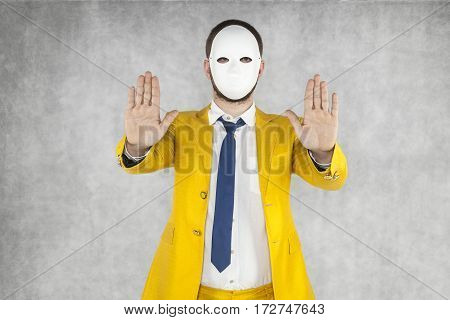 Incognito Person Performs Stop Gesture