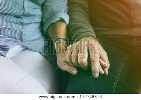 lovely senior adult sweet couple holding hand together