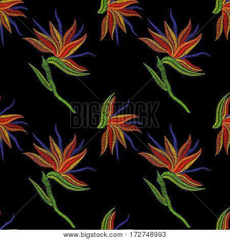 Embroidery Bird of Paradise flowers, tropical Strelitzia seamless pattern. Vector fashion ornamental floral print on black background for fabric traditional folk decoration.