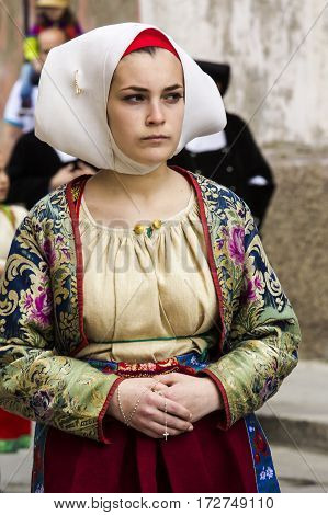 CAGLIARI, ITALY - May 1, 2016: 360 Feast of Saint Efisio - Portrait of a beautiful girl in traditional Sardinian costume - Sardinia