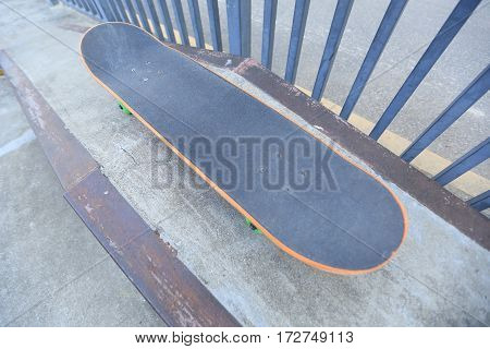 closeup of one skateboard at skatepark ramp ready for riding
