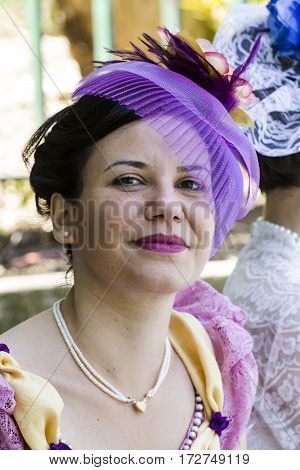 CAGLIARI, ITALY - May 29, 2016: Sunday at La Grande Jatte VIII Ed. At the Public Gardens - Portrait of a beautiful woman in Victorian costumes - Sardinia