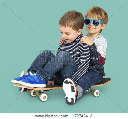 Little Kids Smiling Playing Sitting Skateboard