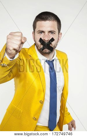 Businessman Clenches His Fist In A Gesture Of Struggle For Freedom Of Speech