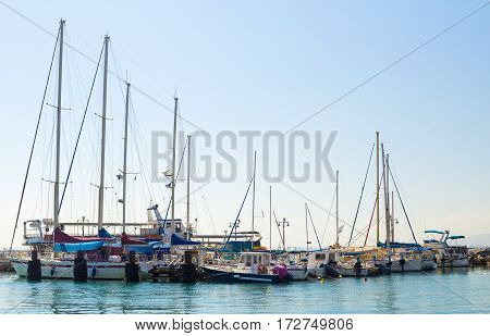 Sailboats at the marina in Akko Israel. Moored boats on the water in a sunny day
