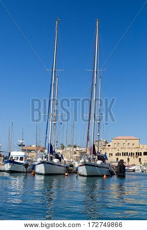 Sailing yachts are moored in marina in Acre Israel. Sunny summer day mediterranean sea
