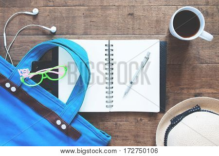 Flat lay set of notebook pen girl accessories and a cup of coffee Top view on wood background