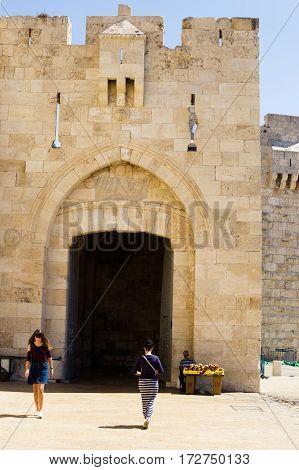JERUSALEM ISRAEL - CIRCA SEP 2016: Jaffa Gate close-up shot. Tourists tourists coming and going out.