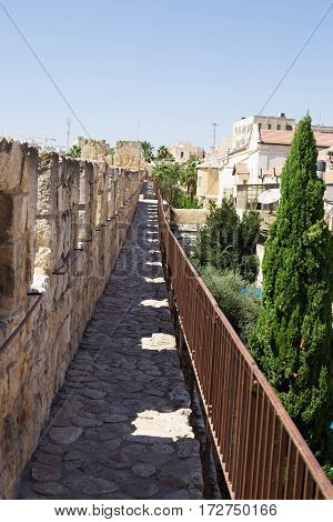 The passage along the wall which surrounds the Old City of Jerusalem. Nobody on the walkway. Israel