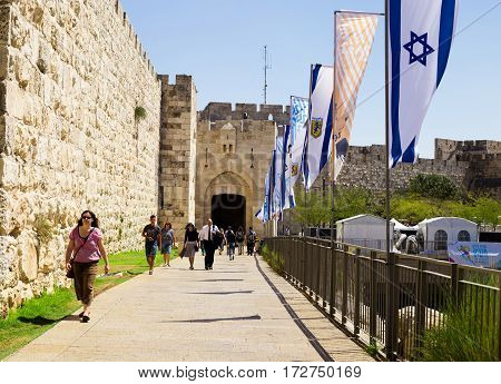 JERUSALEM ISRAEL - CIRCA SEP 2016: Alley leading to the Jaffa Gate. Tourists at the entrance to the Jaffa Gate