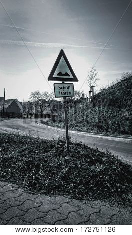 German traffic sign for Drive slowly in black and white