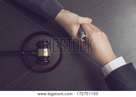 Top view of a corrupted judge taking a bribe money. Selective focus