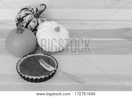 Three Pumpkins With Small Pumpkin Pie And Fork