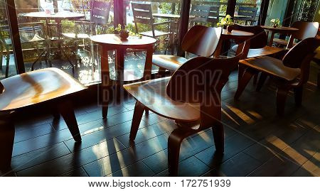 Street view of a coffee terrace with tables and chairs