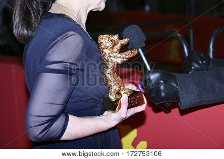 Ildiko Enyedi, award detail, poses with the  Best Film 'On Body and Soul' after the closing ceremony of the 67th  Film Festival Berlin at Berlinale Palace on February 18, 2017 in Berlin, Germany.