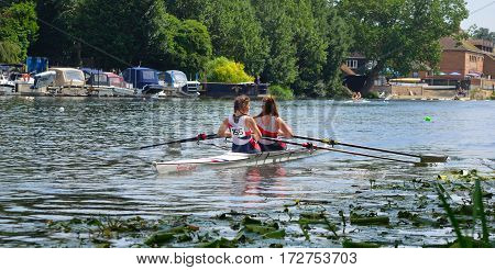 ST NEOTS, CAMBRIDGESHIRE, ENGLAND - JULY 23, 2016: Young women in Pairs Sculling on the river Ouse at St Neots.