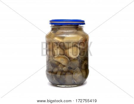 marinated wild mushrooms in a jar on a white background. horizontal photo.