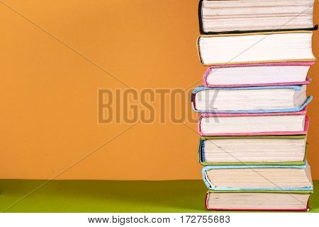 Set of colored books on bright colorful background.free copy space. Back to school copy space. Education background.