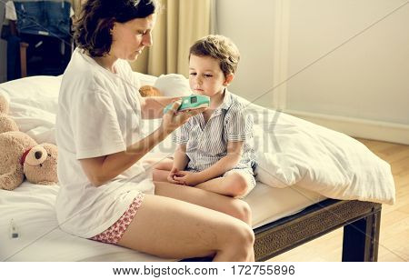 Son Get Sick and His Mom Checking Temperature