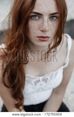 beautiful redhead girl with blue eyes and freckles