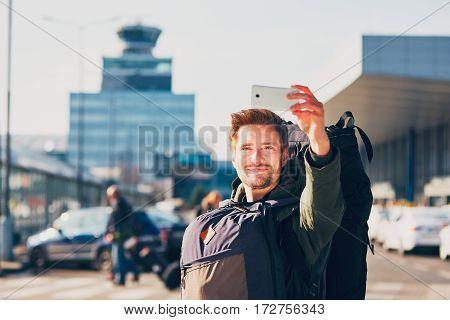 Traveler taking a selfie at the airport. Prague Czech Republic.