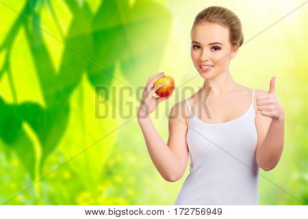 Young healthy woman on spring background