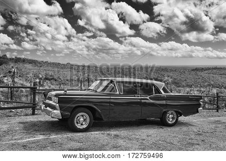 Pinar del Rio Cuba - January 292017: Old Ford Fairlane on the road in Valley de Vinales. Thousands of these cars are still in use in Cuba and they have become an iconic view and a worldwide known attraction