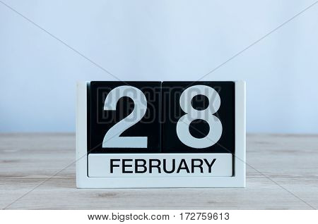 February 28th. Cube calendar for february 28 on wooden surface with empty space For text. Not Leap year or intercalary day.
