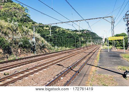 Twin Rail Tracks Leading Through Rural Railway Station