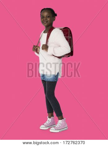 Young black kid student with a backpack full body portrait