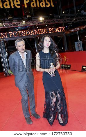 Kim Min-hee, Hong Sangsoo  pose the Silver Bear award for best actress after the closing ceremony of the 67th Film Festival Berlin at Berlinale Palace on February 18, 2017 in Berlin, Germany.