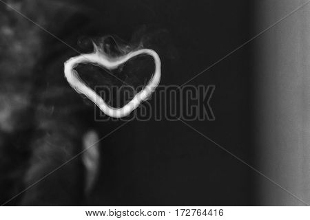 Ring Out Of Steam In The Shape Of A Heart From E-cigarette For Background. Vaping. Black And White P