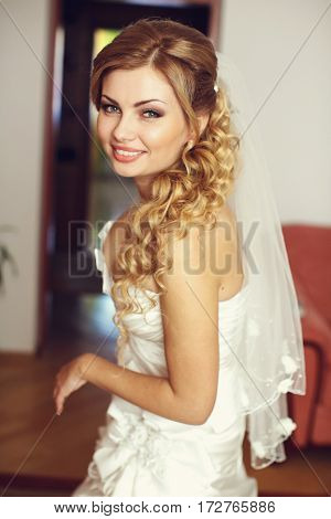 Pretty Blonde Bride With Long Hair Smiles Looking Over Her Shoulder