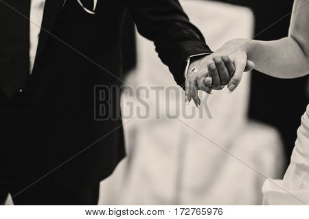 A Close-up Of Tender Bride's Arm Held By A Groom