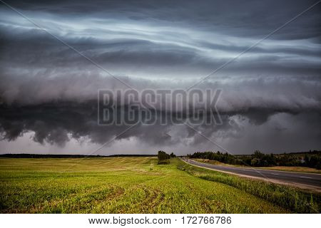 storm clouds over the sloping field in autumn